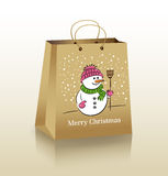 Christmas Shopping Bag. Christmas Cardboard Shopping Bag With a Snowman Royalty Free Stock Photos