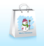 Christmas Shopping Bag. With a Cheerful Snowman Stock Photography