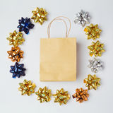 Christmas shopping bag with bows and stars on white background. Stock Photo