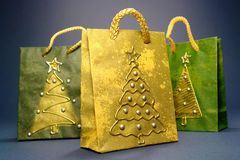 Christmas shopping bags. Three christmas shopping bags over dark blue background Stock Images