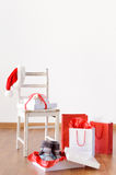 Christmas shopping with bags, presents, gift boxes and santa hat Stock Images
