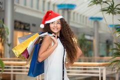 Christmas Shopping. Beautiful Happy Girl With bags Stock Images