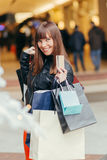 Christmas Shopping. Beautiful Happy Girl With Credit Card In Shop Stock Images