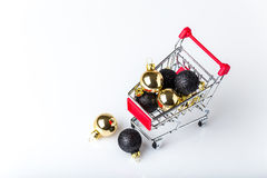 Christmas shopping cart with balls Stock Photography
