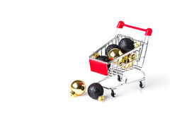 Christmas shopping cart with balls Royalty Free Stock Photos