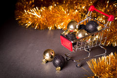 Christmas shopping cart on a black background Royalty Free Stock Photo