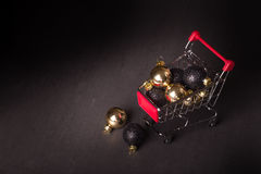 Christmas shopping cart on a black background Stock Photography