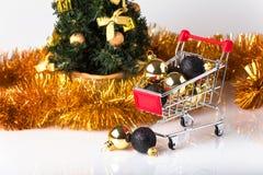 christmas shopping cart with christmas tree Stock Image