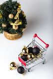 christmas shopping cart with christmas tree Royalty Free Stock Photo