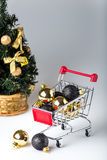 Christmas shopping cart with christmas tree Royalty Free Stock Photography