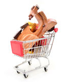 Christmas shopping cart with gifts and toys Royalty Free Stock Photo