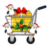 Christmas shopping cart and penguins Royalty Free Stock Photo