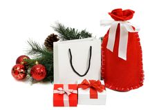 Christmas shopping. Christmas composition with Santa Claus bag, Shopping Bag, fir tree, cones, balls and gifts. Isolated white Royalty Free Stock Photo