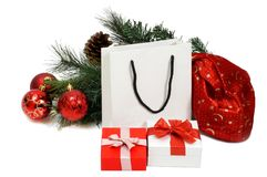 Christmas shopping. Christmas composition with Santa Claus bag, Shopping Bag, fir tree, cones, balls and gifts. Isolated white Stock Images