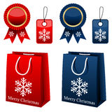 Christmas Shopping Collection. Collection of Christmas sale elements: shopping bags, award ribbons and gift tags in two different colors (red and blue), isolated Royalty Free Stock Photo
