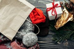 Christmas shopping concept. big sale. seasonal rustic background. With bags of buyed clothes presents. advertising with space for text royalty free stock photos