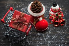 Christmas shopping concept on wood background. Christmas holiday shopping concept on wooden background with winter decoration of pine cones on santa sock, snow stock images