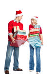 Christmas shopping couple carrying gifts Stock Photos