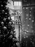 Christmas shopping frenzy. Artistic look in black and white. Royalty Free Stock Images