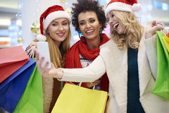 Christmas shopping with friends Royalty Free Stock Image
