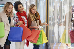 Christmas shopping with friends Stock Photos
