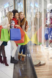 Christmas shopping with friends Stock Images