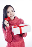 Christmas shopping gift card isolated in white. Woman showing  gift card while holding white present isolated in white Royalty Free Stock Photo