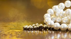 Christmas shopping, gift pearls for women - gold banner, backgro stock photo