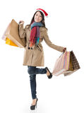 Christmas shopping girl holding bags Royalty Free Stock Photography