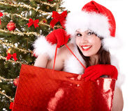 Christmas shopping of girl in santa hat, fir tree Royalty Free Stock Image