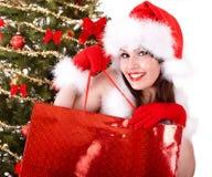 Christmas shopping of girl in santa hat, fir tree royalty free stock image
