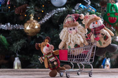 Christmas shopping. Happy Christmas characters pushing shopping cart Stock Images