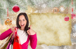 Christmas Shopping. Happy young girl with shopping bags. Royalty Free Stock Photo