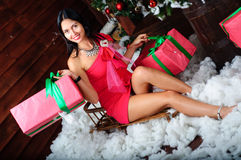 Christmas shopping. Hristmas shopping, gifts, girl on sleigh Royalty Free Stock Photos
