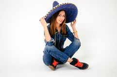 Sombrero girl. Hristmas shopping, gifts, girl on sleigh Stock Image