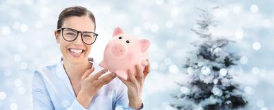 Christmas shopping, laughing fun woman with piggy bank isolated Royalty Free Stock Photos