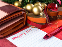 Christmas shopping. List with pen and wallet royalty free stock images
