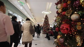 Christmas shopping in mall stock video footage