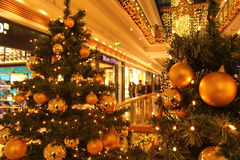 Christmas shopping at the mall. Christmas trees in a shopping mall reminding of winter holiday period royalty free stock photo