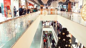 Christmas shopping mania in big black friday sales. Christmas decorated shopping center with two floors and buyers. Christmas crowd of people mania on black stock footage