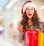 Christmas Shopping. Sales. Christmas Shopping. Woman with Bags in Shopping Mall. Sales stock photos