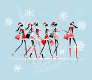 Christmas Shopping, Santa Girls With Bags Stock Photo