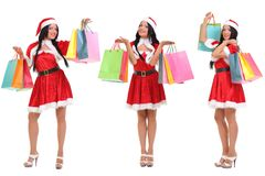 Christmas Shopping santa woman. Woman dressed as Santa stock image