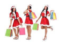 Christmas Shopping santa woman. Woman dressed as Santa royalty free stock photo