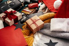 Christmas shopping and seasonal sale. Gift box, credit cards, mo. Ney, wallet, bags, clothes, jewelry, santa hat, scarf on rustic wood. Space for text royalty free stock image