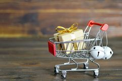 Christmas shopping: Shopping cart with Christmas gift Royalty Free Stock Photo