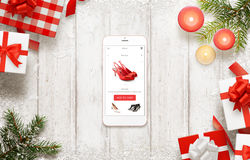 Christmas shopping with smart phone. Buying shoes online on commerce web site or app Stock Images