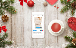 Christmas shopping with smart phone on commerce web site Stock Photos