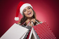 Christmas shopping. Smiling woman with christmas shopping stock photography