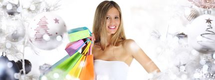 Christmas shopping, smiling woman with bags on christmas ball tr royalty free stock photos